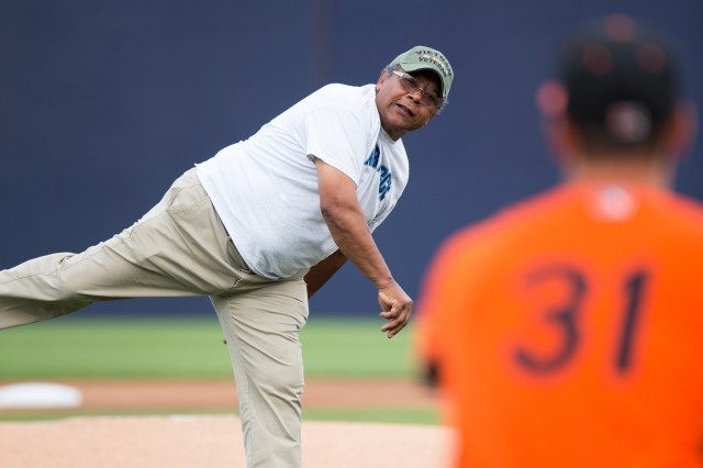 Cliff Banks, representing veterans of the Vietnam War, throws the first pitch during the Frederick Keys Military Appreciation Night, Aug. 10.