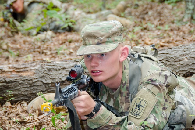Pvt. Jacob Bozeman, Soldier in training, provides security while his teammates conduct squad training during FTX 2.