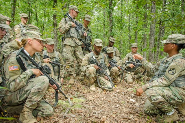 Right, Sgt. Deondra Haslam, drill sergeant, describes squad movements to Company A during FTX 2 at Fort Leonard Wood, Missouri.