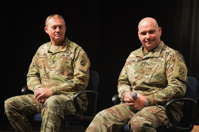 Chief Warrant Officer 3 Patrick Schorn (right), executive officer, C Company, 6th Battalion, 1st Special Warfare Training Group and 1st Sgt. David Rose (left), first sergeant, C Co. 6th Bn, 1st SWTG, field a question from a student during a brief on Special Forces, Apollo High School auditorium, Sept. 13, Glendale, Ariz. The Phoenix battalion hosted Schorn and Rose from Fort Bragg, N.C., on a tour of Phoenix area high schools, Sept. 11-13, in an attempt to educate students on the opportunities available in Special Forces and the U.S. Army. (U.S. Army Photo by Alun Thomas, USAREC Public Affairs)