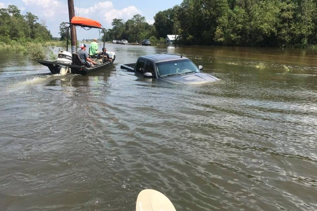 Ward said he wasn't able to get many pictures of the flooded areas. Rescuers who ran boats were focused on search and rescue and recovery efforts rather than taking pictures, he said. But, he added, taking pictures of people who have lost everything, and looking at the expressions of despair in their faces wasn't something he felt he could photograph to share.