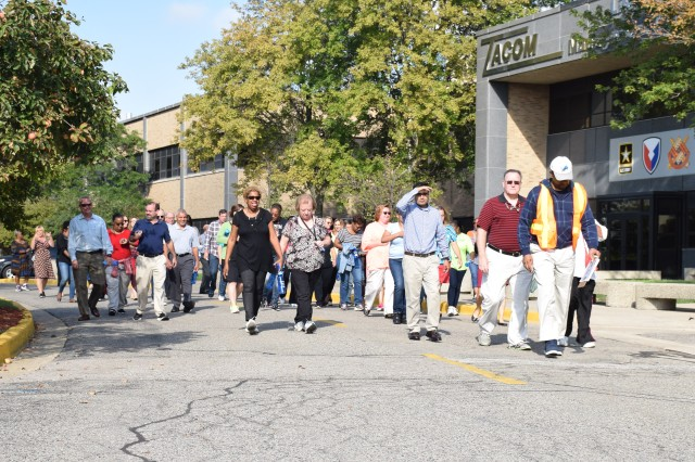 Detroit Arsenal employees walk the perimeter to bring awareness to suicide.