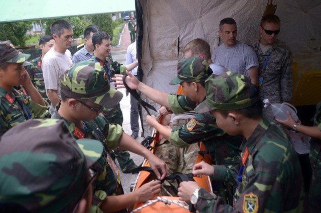 A group of doctors and nurses with Vietnam's National Committee for Incident, Disaster Response, and Search and Rescue (VINASARCOM), work alongside members of the Oregon National Guard's CBRNE Enhanced Response Force Package (CERFP) during the August 2017 Disaster Management Engagement Activity held in Hanoi, Vietnam. The CERFP worked alongside representatives from the U.S. Marine Corps in order to share information and tactics for chemical disaster response with their partners in Vietnam's National Committee for Incident, Disaster Response, and Search and Rescue (VINASARCOM).