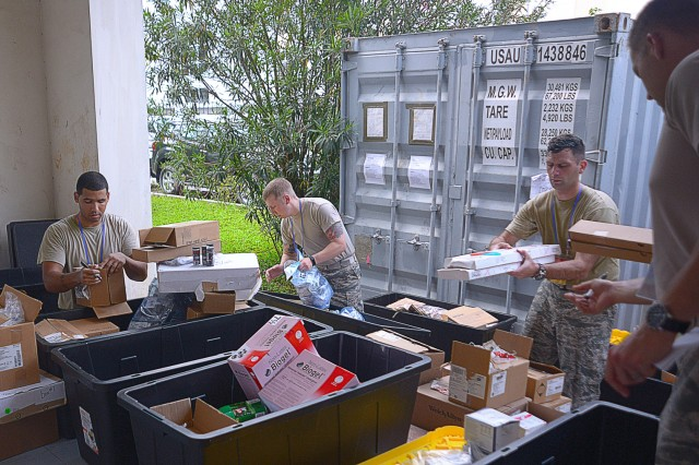 From left to right: Oregon National Guard Staff Sergeants Paul Barrett and Carson Mather, Capt. Mathew Keelin and Maj. Christopher Webb, members of the Oregon National Guard's CBRNE Enhanced Response Force Package (CERFP), inventory two connexes of medical supplies and equipment in preparation for the 2017 Disaster Management Engagement Activity (DMEA) held in Hanoi, Vietnam, August 2017. They worked alongside representatives from the U.S. Marine Corps in order to share information and tactics for chemical disaster response with their partners in Vietnam's National Committee for Incident, Disaster Response, and Search and Rescue (VINASARCOM).