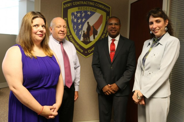 Doug Greene, third from left, leads the Green Platoon Integrated Training and On-The-Job Training Program established at the Army Contracting Command-Redstone. Assisting new contracting employees are subject matter experts Sarah Shaffer, at left, and Deanna Kokocha, and technical advisor Pat Rhode.
