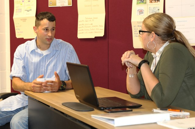 Sgt. Steve Gibley, a student in the EO Ambassadors Course from U.S. Army Human Resources Command, goes through an EO vignette with Sgt. 1st Class Mary Byrne, U.S. Army Cadet Command and Fort Knox EO Office, during the course Aug. 30.
