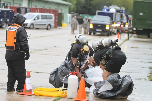 United States Army Reserve Soldiers of the 773rd Civil Support Team, 7th Mission Support Command, remove protective gear after searching for a simulated contamination threat during a certification exercise Sept. 15, 2017 on Daenner Kaserne in Kaiserslautern, Germany.