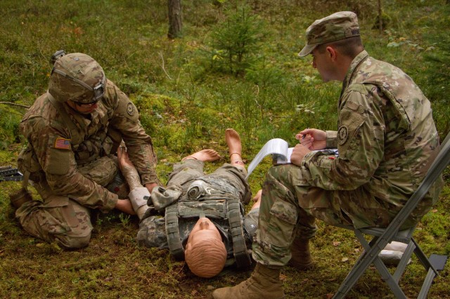 A candidate from 2d Cavalry Regiment is tested on his ability to control bleeding on a casualty Sept. 12, 2017 on the Medical Lane during 2CR Expert Infantry Badge testing week in the Grafenwoehr Training Area, Germany. The Regiment hosted the EIB training and test week Sept. 6 -- 15. Candidates must pass, to standard and time, an Army Physical Fitness Test, day and night land navigation, 30 tasks, 12-mile ruck march and the Objective Bull event.