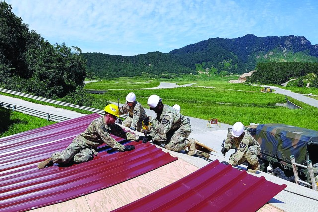 Sgt. Kyle Zulkoski, Spc. Kurtis Kwick, Spc. Timothy Green and Pvt. 1st Class Taehyeong Ahn of the 643rd Engineer Support Company rebuilt several structures at Rodriguez Range Live fire Complex during exercise Ulchi Freedom Guardian  in South Korea.