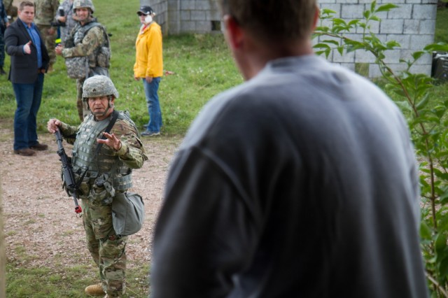 Sgt. Marc Stelter, soldier with Charlie Company (C Co.), 457th Civil Affairs Battalion (CA BN), interacts with a role-player during training exercise Cobra Strike 17 led by C Co, 457th CA BN, in Wackernheim, Germany, Sept. 16, 2017. This local multi-partnered exercise tests civil affairs solders' assessment skills in a fictitious post-earthquake disaster scenario and coordination with local emergency services (U.S. Army Reserve photo by Capt. Jeku Arce, 221st Public Affairs Detachment).