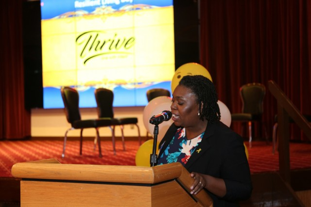 RaShonda Labrador, event organizer and program manager for Army Substance Abuse Program, addresses the audience during Resilient Living Day Sept. 15, 2017 at Camp Zama Community Club. (U.S. Army photo by Lance D. Davis)