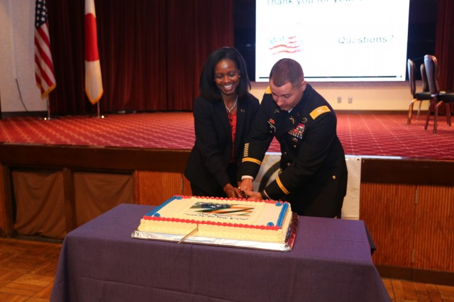 Keynote speaker Maria Bentinck, left, deputy director for Army Retirement Services at the Pentagon, and Col. Phillip Gage, right, commander of U.S. Army Garrison Japan, cut the cake for Resilient Living Day Sept. 15, 2017 at Camp Zama Community Club. (U.S. Army photo by Lance D. Davis)