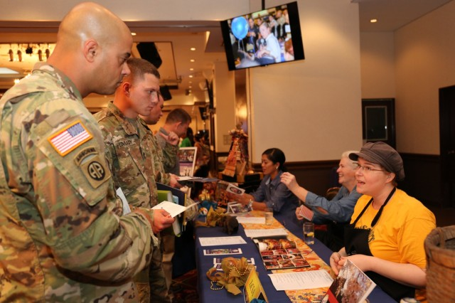 Soldiers speak with members of the Zama Community Spouses Association for Resilient Living Day Sept. 15, 2017 at Camp Zama Community Club. (U.S. Army photo by Lance D. Davis)