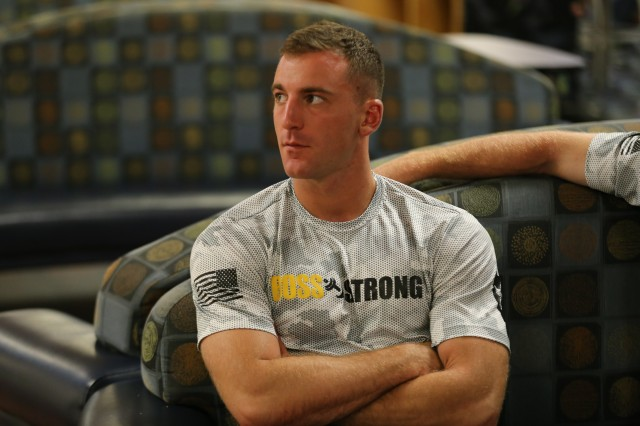 Pfc. Nicholas Angelo concentrating on instruction for competition