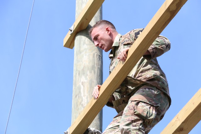 Pfc. Nicholas Angelo, from Camp Humphreys, Korea, participating in obstacle course training at Camp Bullis, north of San Antonio, as part of the BOSS Strong Championship which focuses on functional fitness. The program is organized by the U.S. Army Installation Management Command's G9 Family and Morale, Welfare and Recreation division to coordinate with existing facilities and outside contractors to develop the future of functional fitness. Photo by Robert Dozier, IMCOM Public Affairs.