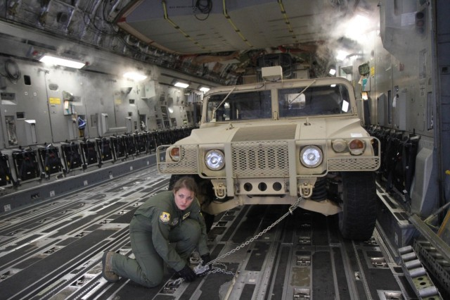 HUNTER ARMY AIRFIELD, GA -- An Airman secures equipment and vehicles down on a C-17 Globemaster III before C Company, 63rd Expeditionary Signal Battalion, 35th Theater Tactical Signal Brigade's relief deployment to Texas in support of Hurricane Harvey.