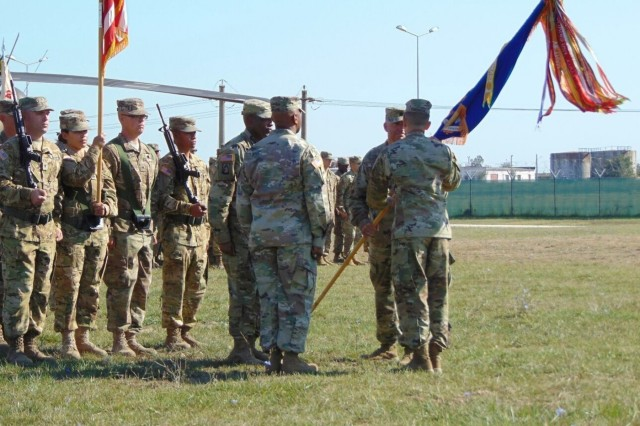 Command Sgt. Maj. Ronnie B. Littler passes of 2-10 Assault Helicopter Battalion's guidon during a Change of Responsibility ceremony at Mihail Kogalniceanu, Romania, on September 15. The passing of the guidon is a symbolic gesture that signifies the transfer of responsibility and duties as the battalion's senior enlisted advisor. (U.S. Army photo by Pfc. William Minnick) 170915-A-TZ475-003