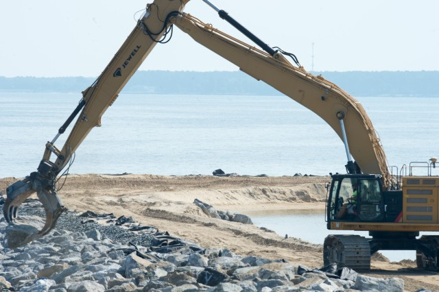 A contractor, working with the Army Corps of Engineers, carefully places a giant rock on the perimeter of a newly developed cell area at the Poplar Island site Aug. 2, 2017.