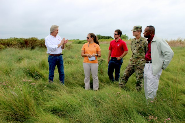Justin Callahan, Poplar Island project manager, gives Army Corps of Engineers personnel a brief tour of the island, Sept. 20, 2016.