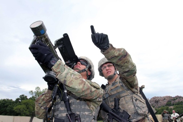 Pvts. Austin Miller and Ronald Taylor, B Battery, 2nd Battalion, 6th Air Defense Artillery, use a Stinger missile to target a simulated unfriendly aircraft during training May 23, 2017 at Fort Sill's Camp Eagle. The two, whose military occupational specialty is with Patriot long range missiles, also learned to use short range air defense in the Stinger missile pilot program. SHORAD is a priority for the Army, as spelled out in 2016's Strategic Portfolio Analysis and Review.