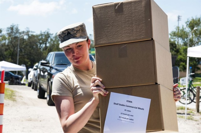 South Carolina Army National Guard Sgt. Madison Covington distributes food to a residents in Hillsborough County, Florida, Sept. 16, 2017, during relief efforts in Hurricane Irma's aftermath. The Army and sister services are also preparing to provide relief for Puerto Rico and the U.S. Virgin Islands following Hurricane Maria.