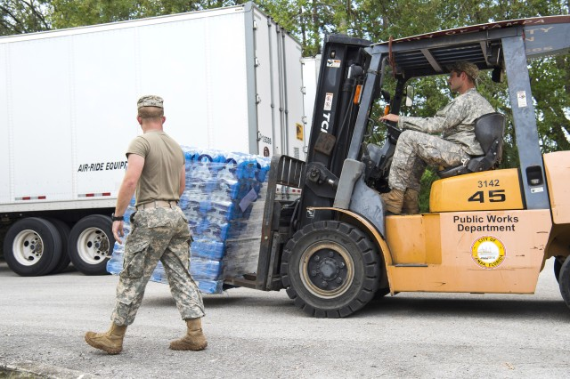 A South Carolina Army National Guardsman guides a team member operating a forklift with a pallet of water to be handed out to residents in Hillsborough County, Florida, Sept. 15, 2017, during relief efforts in Hurricane Irma's aftermath. The Army and sister services are also preparing to provide relief for Puerto Rico and the U.S. Virgin Islands following Hurricane Maria.