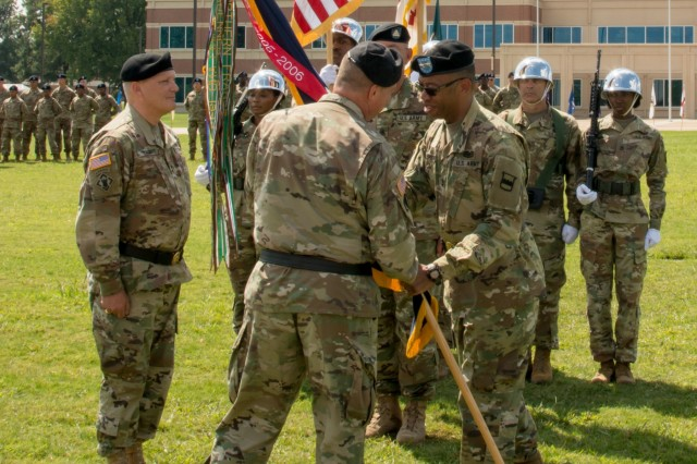 (Right) Outgoing Commander of the 80th Training Command Maj. Gen. A.C. Roper hands the unit's colors to Deputy Commanding General of the U.S. Army Reserve Command Maj. Gen. Scottie D. Carpenter at the 80th's change of command ceremony at Fort Lee, Virginia, Sept. 17, 2017.