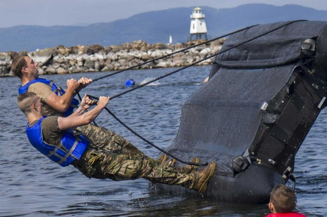 U.S. Army National Guard Soldiers with 86th Infantry Brigade Combat Team (Mountain), Vermont Army National Guard, right a zodiac boat during boat capsizing training, Burlington, Vt., Aug. 12, 2017. Charlie Troop conducted water training for proficiency in water-based recon missions.