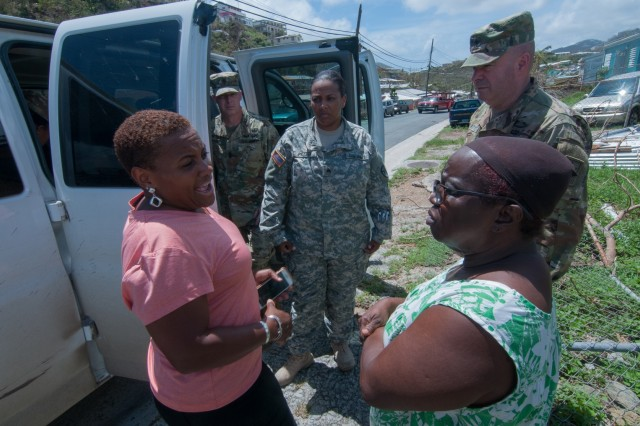Special Assistant to the Director of the Army National Guard, Brig. Gen. John Boyd and Sgt. Maj. Douglas Conaway, senior enlisted leader for the Operations and Training Directorate, ARNG; both with the National Guard Bureau, visited communities in St. Thomas that had been ravaged by Hurricane Irma, Sept. 16. Monique Doute-Ferrell, a member of the Senior Executive Service and the director of the Army's Sexual Harassment Assault Response and Prevention program and a St. Thomas native home for a visit with Ruth Pratt, a Tutu Valley resident.