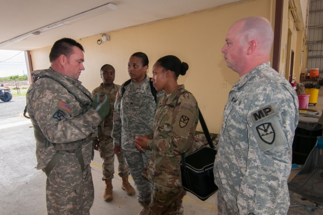 Sgt. Paul Scribner; a UH-60L Black Hawk crew chief gives a safety brief to Pfc. Shenequa Hector; Sgt's Jovani Peter and Debbie-Ann Nanton-Smith and Capt. Peter Sylvia; prior to them boarding the aircraft; Sept. 16.; The group accompanied Brig. Gen. John Boyd; special assistant to the Director of the Army National Guard; on a site visit to St. Thomas in areas that hit hard by Hurricane Irma.