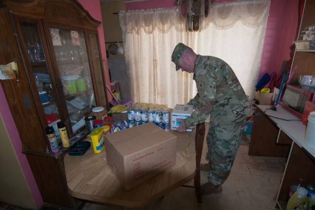 Special Assistant to the Director of the Army National Guard, Brig. Gen. John Boyd distributes emergency rations and water to Hurricane Irma victims in St. Thomas, Sept. 16. Boyd visited communities in St. Thomas that had been ravaged by Hurricane Irma.