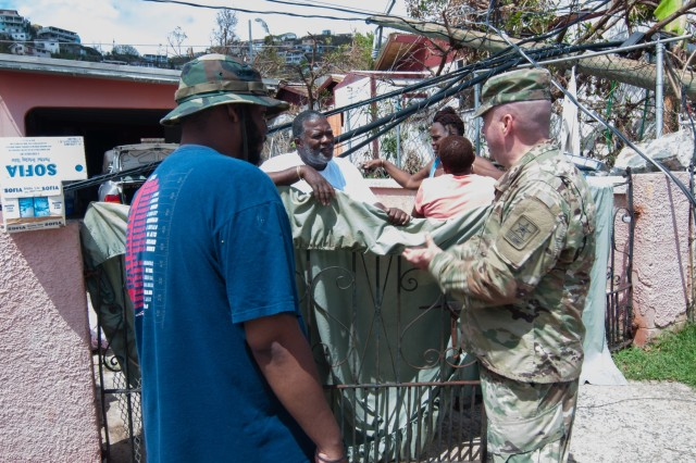 Special Assistant to the Director of the Army National Guard, Brig. Gen. John Boyd and Sgt. Maj. Douglas Conaway, senior enlisted leader for the Operations and Training Directorate, ARNG; both with the National Guard Bureau, visited communities in St. Thomas that had been ravaged by Hurricane Irma, Sept. 16.