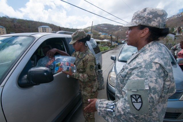 Virgin Islands National Guard soldiers Sgt's and Debbie-Ann Nanton-Smith and Jovani Peter,  hand out emergency rations and water to Old Tutu residents in St. Thomas Sept. 16.  The group accompanied Brig. Gen. John Boyd, special assistant to the Director of the Army National Guard, on a site visit to St. Thomas in areas that hit hard by Hurricane Irma.