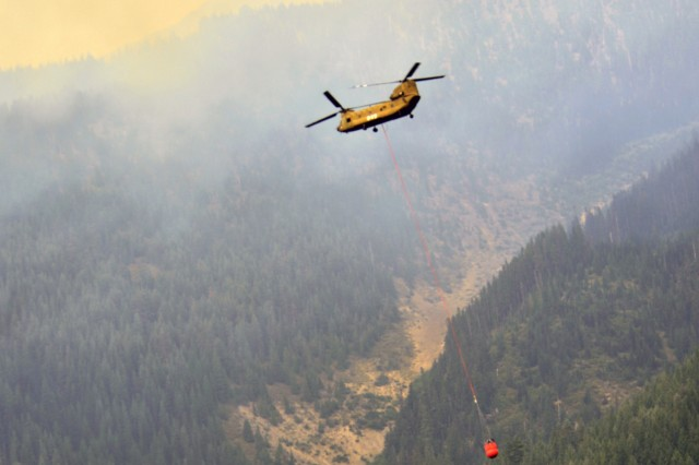 An Oregon Army National Guard CH-47 Chinook helicopter with Bravo Company, 1st Battalion, 168th Aviation Regiment, carries a nearly full 2,000-gallon capacity Bambi Bucket above the Mount Jefferson Wilderness Area in order to support firefighting efforts along a ridge at the Whitewater Fire, August 9, 2017. The Oregon National Guard was called upon to assist following Governor Kate Brown's emergency order on August 2. Two Chinook helicopters from the Pendleton, Oregon, based unit are currently assigned to the fire, along with the necessary flight crew, fuelers, maintainers and operations personnel.