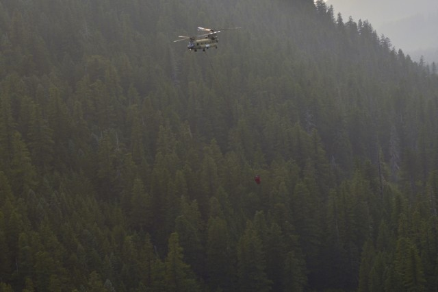 An Oregon Army National Guard CH-47 Chinook helicopter with Bravo Company, 1st Battalion, 168th Aviation Regiment, carries a 2,000-gallon capacity Bambi Bucket to a dip-point above the Mount Jefferson Wilderness Area in order to support firefighting efforts on the Whitewater Fire, August 9, 2017. The Oregon National Guard was called upon to assist following Governor Kate Brown's emergency order on August 2. Two Chinook helicopters and more than 20 personnel from the Pendleton, Oregon, based unit are currently assigned to the fire.