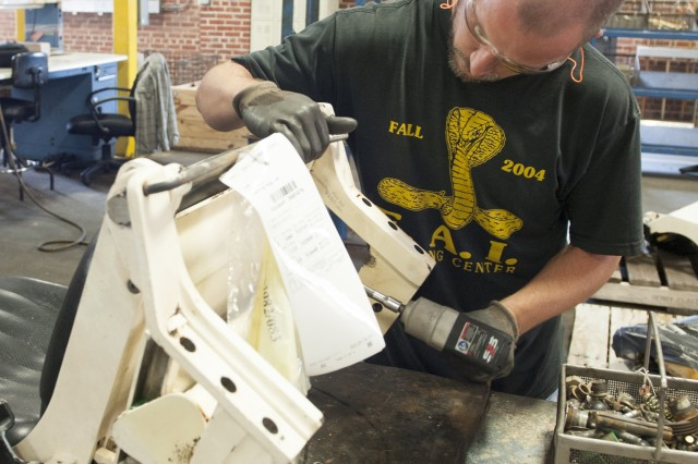 Michael Gannaway disassembles a seat in a component shop at Anniston Army Depot. It's important when using tools to maintain them and use the right tool for the job.