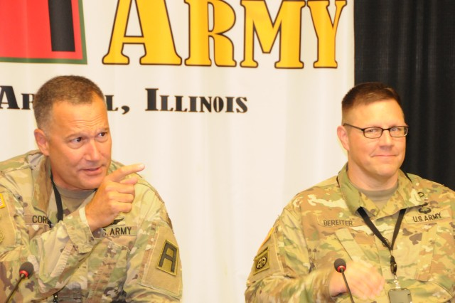 First Army Command Surgeon, Col. Lance Cordoni (left) makes a point during his opening remarks at the First Army Medical Summit on Sept. 20 in the Pershing Conference Room of First Army headquarters on Rock Island Arsenal, Ill. To Cordoni's right is Sgt. Maj. Justin Bereiter, First Army command surgeon sergeant major.