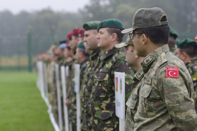 Turkish and Romanian soldiers stand shoulder-to-shoulder in formation during the official closing ceremony for Rapid Trident 17 at the International Peacekeeping Center, Sept. 22, 2017, in Yavoriv, Ukraine. (U.S. Army photo by Sgt. Justin Geiger)