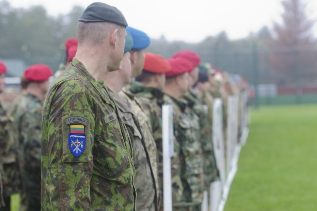 Lithuanian, Polish and Ukrainian soldiers stand shoulder-to-shoulder in formation during the official closing ceremony for Rapid Trident 17 at the International Peacekeeping Center, Sept. 22, 2017, in Yavoriv, Ukraine. (U.S. Army photo by Sgt. Justin Geiger)