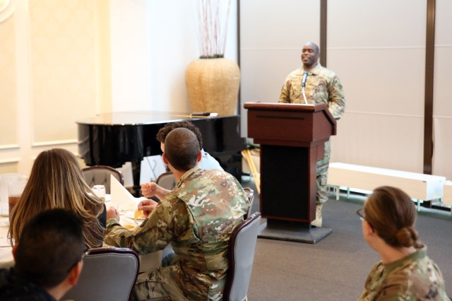 Sgt. Maj. Richard Thomas, the U.S. Army Europe Equal Opportunity sergeant major, speaks to Soldiers, Civilians, local national employees and family members from 2nd Theater Signal Brigade gathered for a prayer luncheon Sept. 22, 2017 at the U.S. Army Garrison Wiesbaden Community Activities Center. Thomas spoke about spoke about faith, resiliency and the EMT process, which he explained as: 1) Establish a firm or stable faith base; 2) Maintain your faith through opposition; and 3) Transform to your surroundings instead of conforming to them.