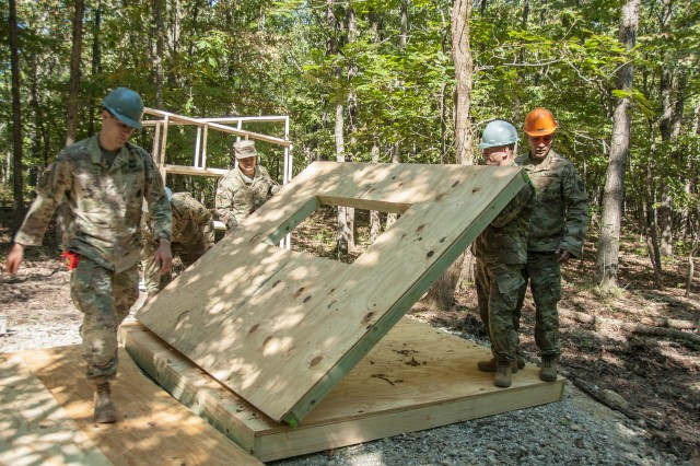 Students from the Noncommissioned Officer Academy's Engineer Advanced Leaders Course construct an 8-by-8-foot wheelchair-accessible hunting blind Sept. 11 for use by area wounded warriors while hunting on Fort Leonard Wood.