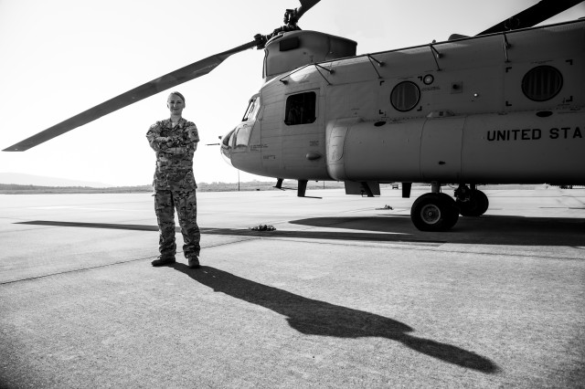 Chief Warrant Officer 2 Sylvia Grandstaff is the first female Warrant Officer Experimental Test Pilot to serve at RTC. Here she is standing next to a CH-47F on the RTC Airfield.