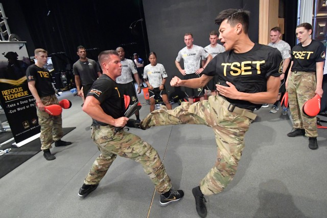 Soldiers from Camp Humphreys, South Korea, watch Pfc. David Kim of the U.S. Army World Class Athlete Program kick coach David Bartlett during a Total Army Enhancement Training (TSET) workout Sept. 14 at the 2017 BOSS Strong Championship at Fort Sam Houston Theatre. U.S. Army photo by Tim Hipps, IMCOM Public Affairs