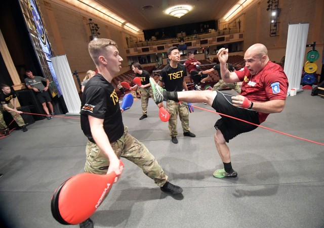 Pfc. Biggers gets kicks from Total Soldier Enhancement Training