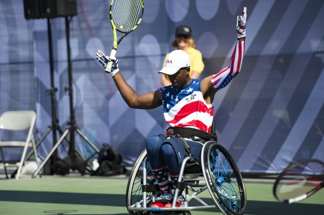 Roosevelt Anderson, a medically retired Army Special Forces sergeant, encourages the crowd to cheer during a wheelchair tennis match against the Canadian team during the 2017 Invictus Games at Nathan Phillips Square in Toronto, Sept. 23, 2017. The Invictus Games, established by Prince Harry in 2014, brings together wounded and injured veterans from 17 nations for 12 adaptive sporting events.