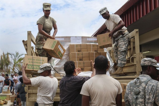 Virgin Islands National Guard members help hand out food and water to civilians at a distribution point on St. Croix in the U.S. Virgin Islands, Sept. 22, 2017, following the aftermath of two major hurricanes in the region.