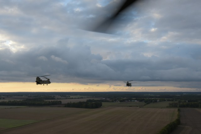 Four CH-47 Chinook helicopters from the 12th Combat Aviation Brigade fly over Gotland, Sweden during an air-assault mission at exercise Aurora 17 Sept. 21, 2017.  Exercise Aurora 17 is an exercise designed to improve, test and show the capabilities of the Swedish Armed Forces.