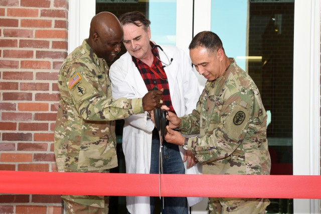Col. Joseph D. Blanding, commander, McAlester Army Ammunition, Dr. Gregory Rogers and Col. Enrique Ortiz, Jr., commander, Reynolds Army Health Clinic at Fort Sill, Oklahoma, cut the ribbon opening the newly-renovated occupational health clinic at the Army installation in southeast Oklahoma, Sept. 20, 2017. Between 200 and 250 patients receive medical care at the clinic each month.
