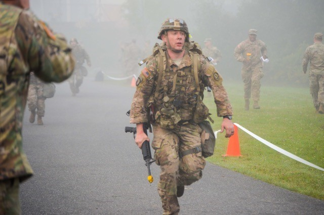A Soldier assigned to 2d Cavalry Regiment crosses the finish line after completing the culminating twelve-mile foot march to earn the Expert Field Medical Badge. Eight soldiers from across the Regiment competed over the course of twelve days in order to earn the EFMB. The graduation ceremony was hosted at the Grafenwoehr Physical Fitness Center at Tower Barracks, Germany, Sept. 28, 2017.