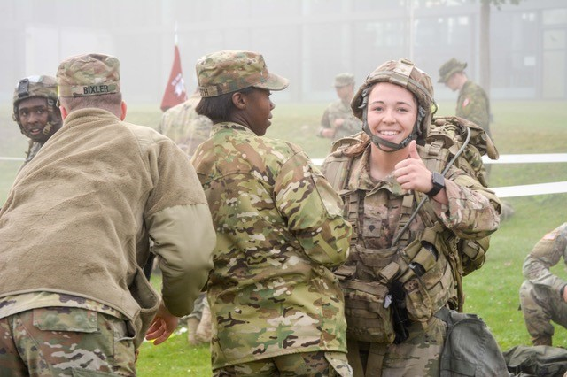 After completing the final task to earn the Expert Field Medical Badge, Spc. Victoria King, Field Artillery Squadron, 2d Cavalry Regiment role one medic, receives assistance in downloading her gear. Participants were required to successfully complete events ranging from combat casualty care, tactical communications and land navigation in order to earn their badge. The graduation ceremony was hosted at the Grafenwoehr Physical Fitness Center at Tower Barracks, Germany, Sept. 28, 2017.